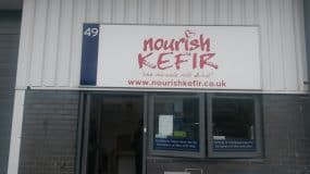 Nourish Kefir door sign